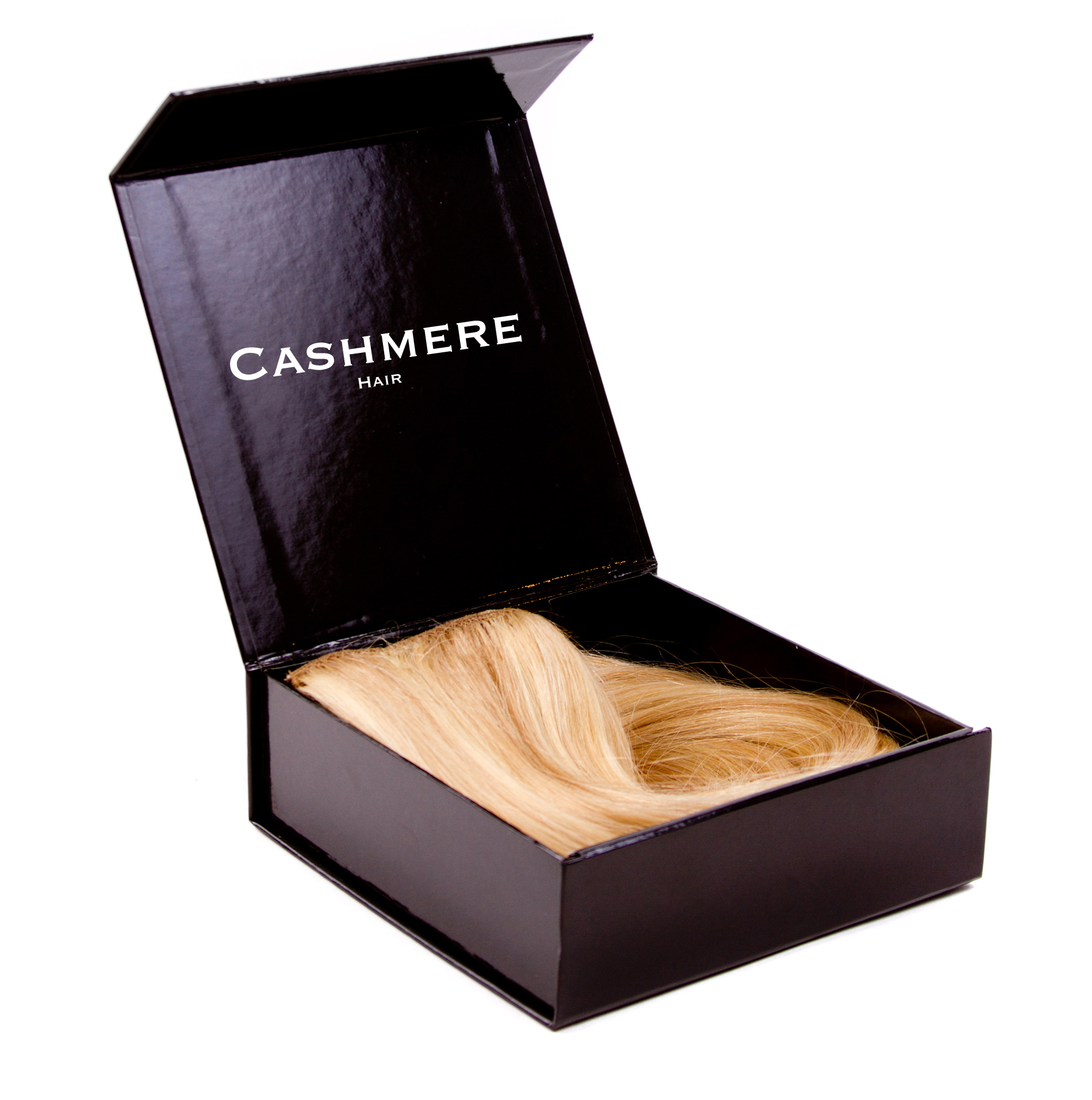 Cashmere Hair is best for travel when stored neatly in the Little Black Box.